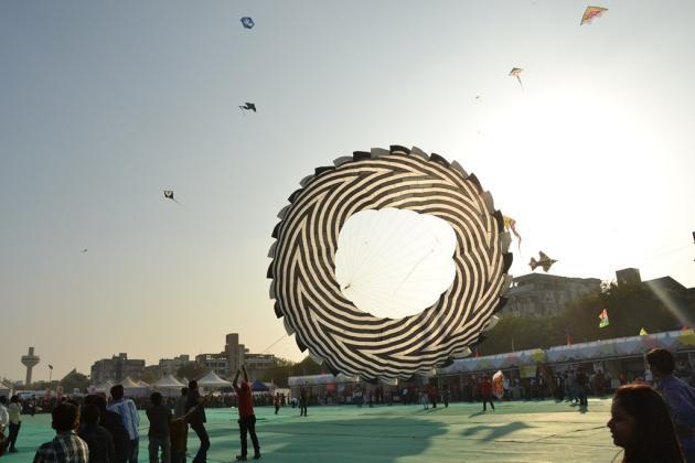 "A kite takes to the air at the International Kite Festival in Ahmedabad  <br><br><br>Photo by Yahoo! reader <a target=""_blank"" href=""http://www.flickr.com/photos/61545942@N08/"">Nisarg Lakhmani</a>"