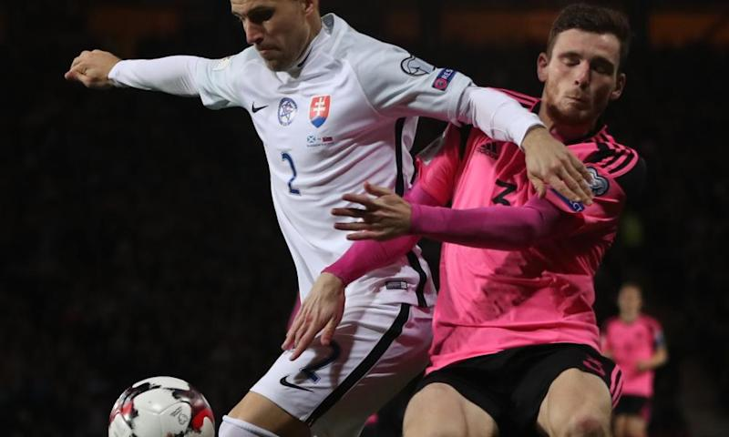 Pretty in pink? Peter Pekarík of Slovakia and Scottish defender Andy Robertson.