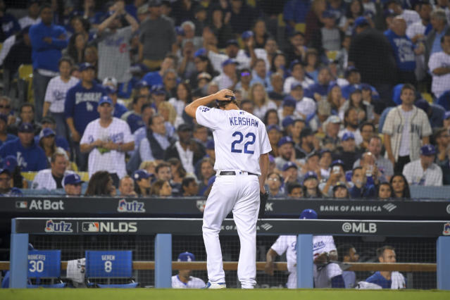 Los Angeles Dodgers pitcher Clayton Kershaw leaves after giving up back-to-back home runs to the Washington Nationals during the eighth inning in Game 5 of a baseball National League Division Series on Wednesday, Oct. 9, 2019, in Los Angeles. (AP Photo/Mark J. Terrill)