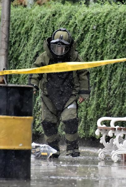 Indonesian bomb squad police check a suspicious box on a main road sidewalk in Jakarta (AFP Photo/Bay Ismoyo)