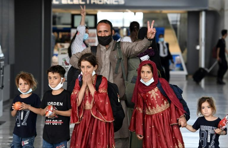 Afghan refugees arrive at Dulles International Airport on August 27, 2021 after being evacuated (AFP/Olivier DOULIERY)