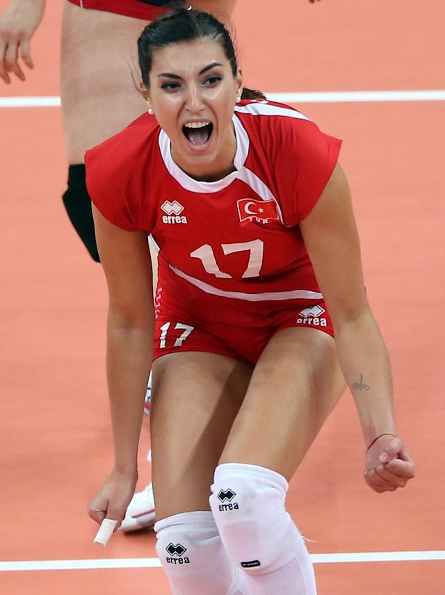 LONDON, ENGLAND - AUGUST 03: Neslihan Darnel #17 of Turkey celebrates the win over Korea during Women's Volleyball on Day 7 of the London 2012 Olympic Games at Earls Court on August 3, 2012 in London, England. (Photo by Elsa/Getty Images)