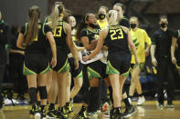 Members of the Oregon bench celebrate a basket against Stanford during the first half of an NCAA college basketball game in Santa Cruz, Calif., Friday, Jan. 8, 2021. (AP Photo/Jed Jacobsohn)
