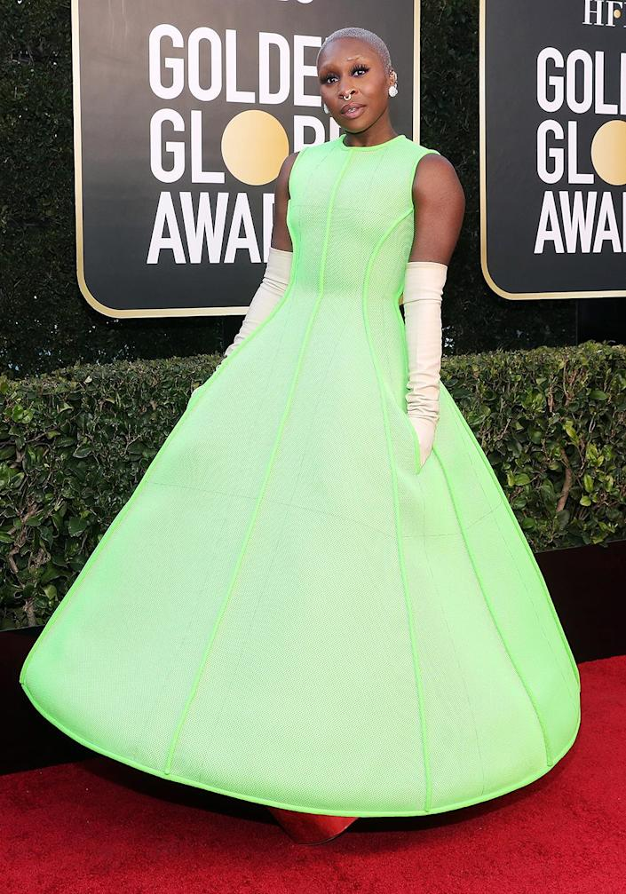 """<p>The actress, who presented live from the Beverly Hilton Hotel during Sunday's show, walked the Golden Globes red carpet in a bright and bold neon green tea-length Valentino Haute Couture dress and sky-high metallic silver platforms. One might assume that such a daring look involved weeks of collaboration between Erivo and her team, but stylist <a href=""""https://www.instagram.com/jasonbolden/"""" rel=""""nofollow noopener"""" target=""""_blank"""" data-ylk=""""slk:Jason Bolden"""" class=""""link rapid-noclick-resp"""">Jason Bolden</a> tells PEOPLE the actress trusted his vision and was totally hands-off this year.</p> <p>""""She had no idea. I came over, and I pulled the dress out. She was like, 'What is that?' I was like, 'This is the Golden Globes dress,'"""" Bolden says. """"She tried it on, zero alterations. She's wearing the exact same shoes from the runway, which are these like stilts.""""</p> <p>According to Bolden, Erivo says the shoes were actually comfortable to walk in!</p>"""