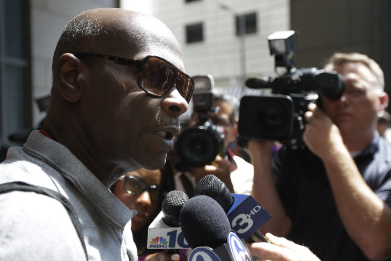Gregory Moton, the father of Adrienne Moton speaks with members of the media outside the center for criminal justice, Wednesday, May 29, 2013, in Philadelphia. Adrienne Moton who pleaded pleaded guilty to third-degree murder and other charges stemming from her work at a corrupt, grimy Philadelphia abortion clinic is going home after being jailed for 28 months. (AP Photo/Matt Rourke)