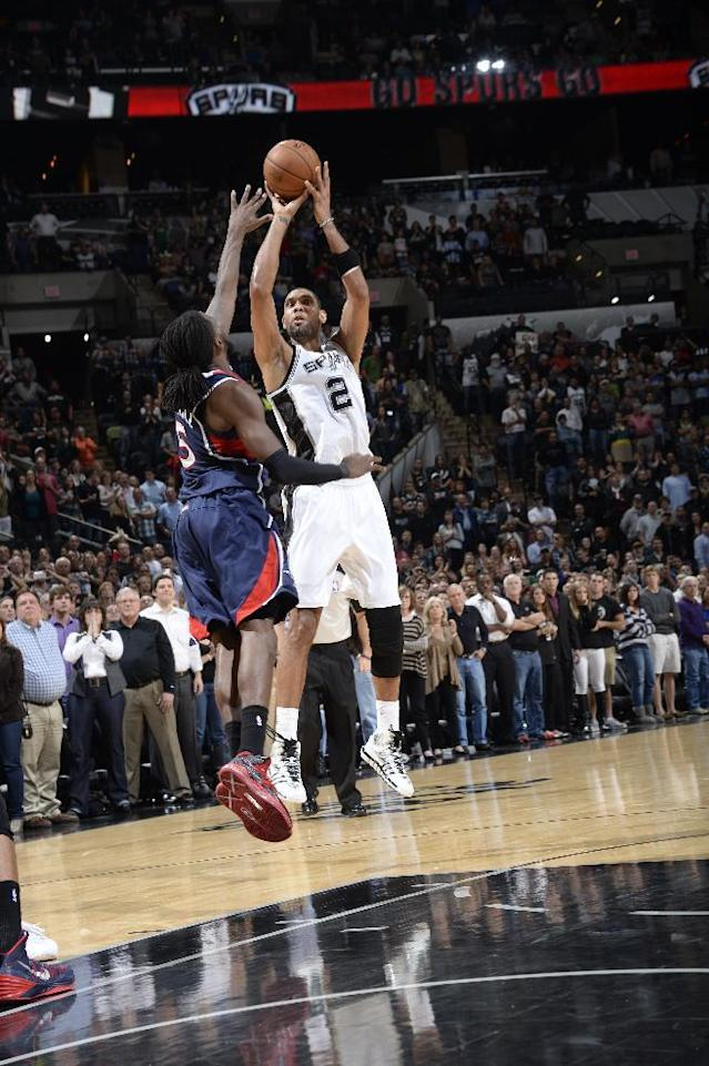 SAN ANTONIO, TX - December 2: Tim Duncan #21 of the San Antonio Spurs hits the game winning shot against the Atlanta Hawks during the game at the AT&T Center on December 2, 2013 in San Antonio, Texas