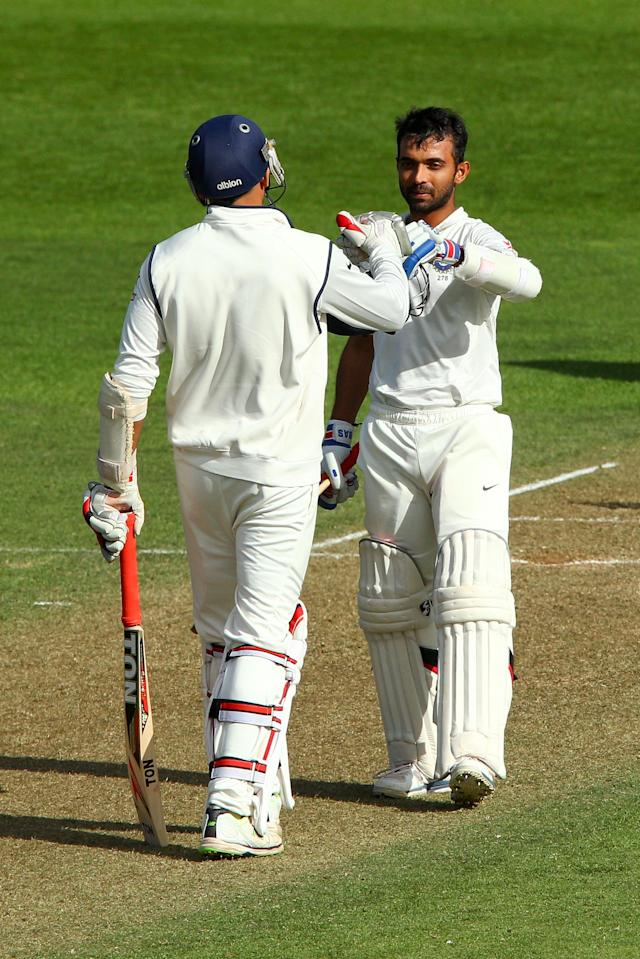WELLINGTON, NEW ZEALAND - FEBRUARY 15: Ajinkya Rahane of India celebrates his century with teammate Zaheer Khan during day two of the 2nd Test match between New Zealand and India on February 15, 2014 in Wellington, New Zealand. (Photo by Hagen Hopkins/Getty Images)