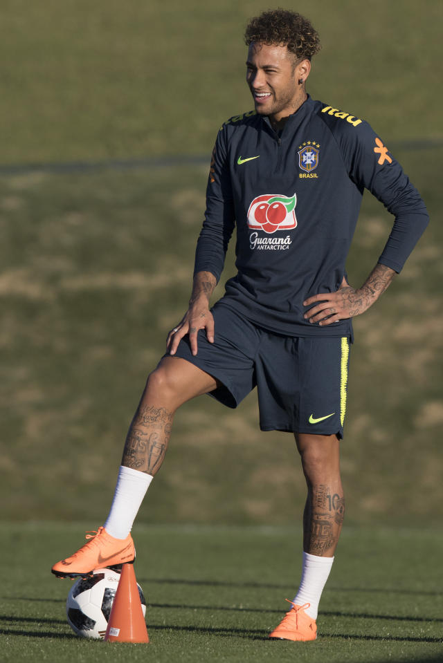 Brazil's Neymar smiles during a practice session of the Brazil national soccer team at the Granja Comary training center, in Teresopolis, Brazil, Tuesday, May 22, 2018. (AP Photo/Leo Correa)