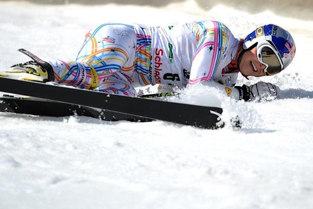 Lindsey Vonn of US reacts in the finish area of the giant slalom on March 18, 2012 during the women's Alpine skiing World Cup Slalom finals in Schladming. AFP PHOTO / SAMUEL KUBANI