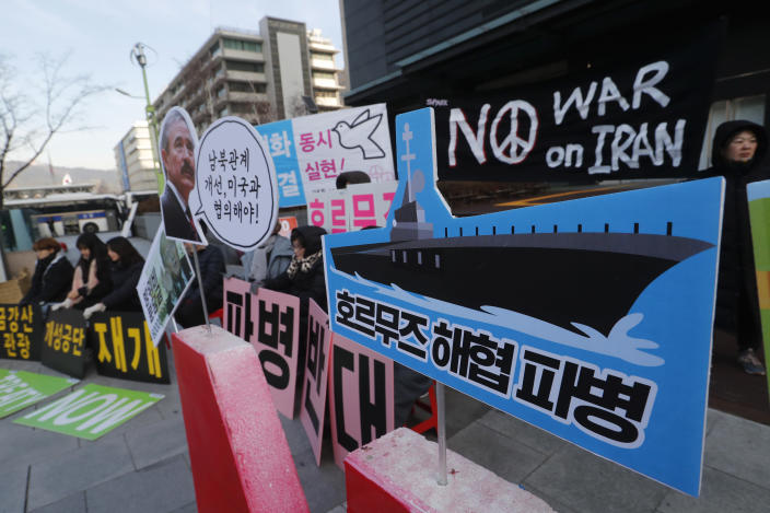 """Anti-war activists stage a rally against the South Korean government's decision to send troops to Hormuz Strait, near the U.S. Embassy in Seoul, South Korea, Tuesday, Jan. 21, 2020. South Korean government on Tuesday said in a press release that the government had decided to send troops to Hormuz Strait to protect South Korean citizens and guarantee the freedom of navigation in the region. The sign reads """"Dispatch of Hormuz Strait."""" (AP Photo/Ahn Young-joon)"""