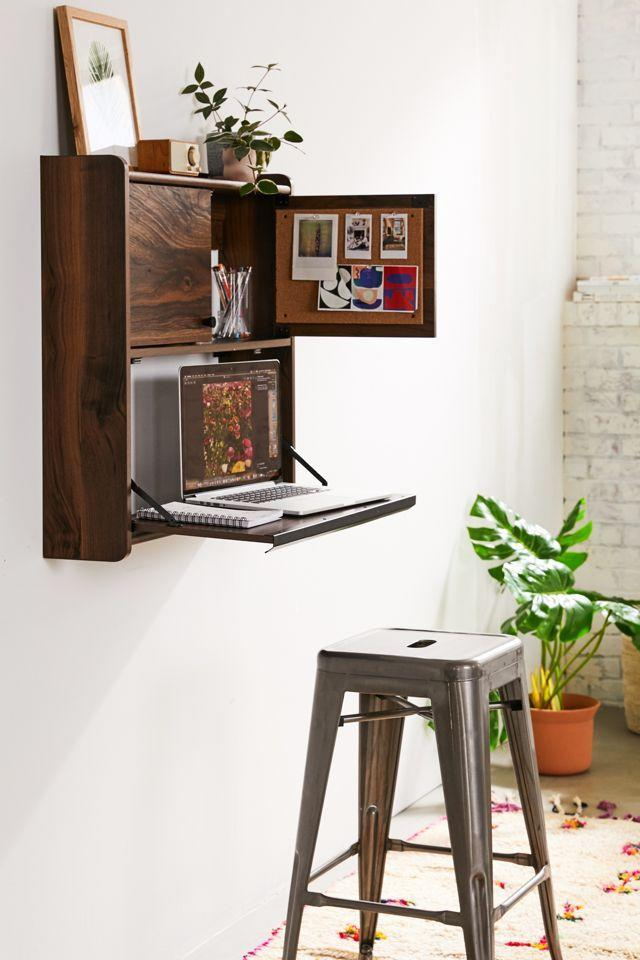 "<h3>Urban Outfitters Murray Wall-Mounted Desk</h3>Personalize your tiny at-home workspace with this slim wall-mounted desk that features a two-door cabinet for stowing away trinkets and supplies, and a bulletin board perfect for pinning daily inspiration. <br><br><br><br><br><strong>Urban Outfitters</strong> Murray Wall-Mounted Desk, $, available at <a href=""https://go.skimresources.com/?id=30283X879131&url=https%3A%2F%2Fwww.urbanoutfitters.com%2Fshop%2Fmurray-wall-mounted-desk"" rel=""nofollow noopener"" target=""_blank"" data-ylk=""slk:Urban Outfitters"" class=""link rapid-noclick-resp"">Urban Outfitters</a>"