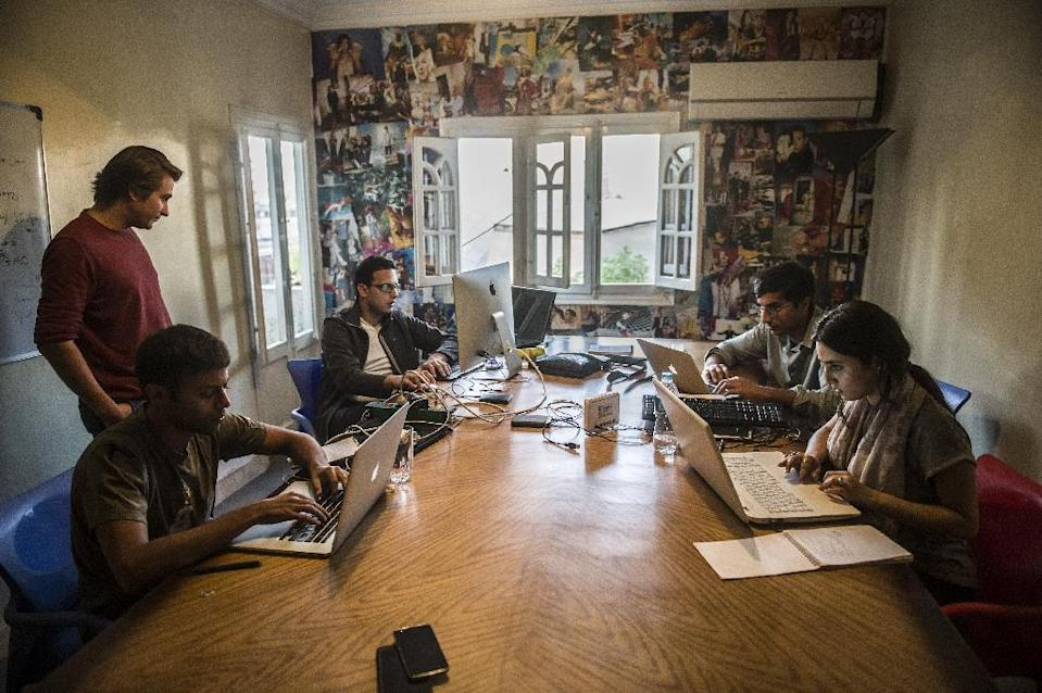 Menna Ayman, Salem Massalha, Shehab el-Dien, Alban Menonville, and Nader Meleika members of the Egyptian startup business, Bassita, work at their office in Cairo (AFP Photo/Khaled Desouki)