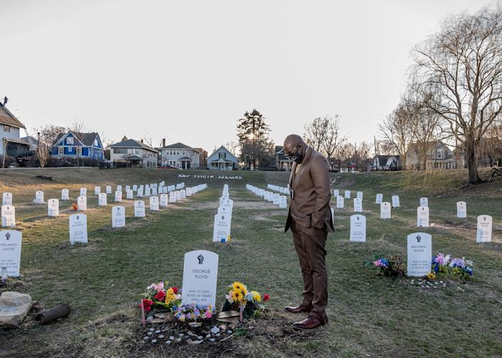 """George Floyd's brother Philonise Floyd visits a protest art installation on April 1. The tombstones bear the names of Black Americans who were lynched by private citizens, fatally shot or choked by police officers, and other victims who died in police custody.<span class=""""copyright"""">Ruddy Roye for TIME</span>"""
