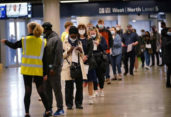 People queue at an NHS Vaccination Clinic at Tottenham Hotspur's stadium in north London (PA)