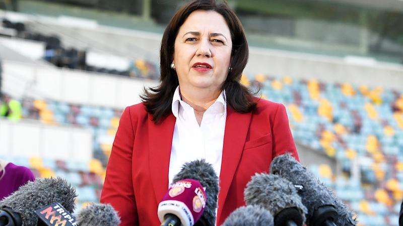 Annastacia Palaszczuk, pictured here at a press conference announcing the 2020 AFL Grand Final at the Gabba.