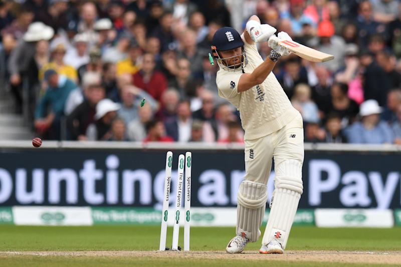 Bails fly as England's Jonny Bairstow is bowled by Australia's Mitchell Starc for 17 during the fourth day of the fourth Ashes cricket Test match between England and Australia at Old Trafford in Manchester, north-west England on September 7, 2019. (Photo by Oli SCARFF / AFP) / RESTRICTED TO EDITORIAL USE. NO ASSOCIATION WITH DIRECT COMPETITOR OF SPONSOR, PARTNER, OR SUPPLIER OF THE ECB (Photo credit should read OLI SCARFF/AFP/Getty Images)
