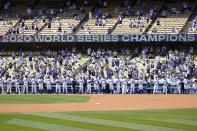 The Los Angeles Dodgers are honored for their 202 World Series Championship before a baseball game against the Washington Nationals, Friday, April 9, 2021, in Los Angeles. (AP Photo/Marcio Jose Sanchez)