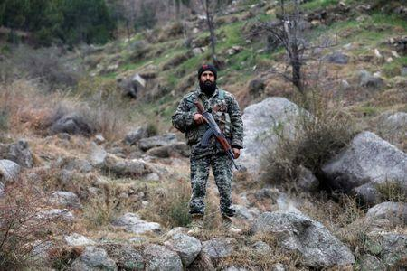 Pakistan's army soldier guards the area, after Indian military aircrafts struck on February 26, according to Pakistani officials, in Jaba village, near Balakot, Pakistan, March 7, 2019. REUTERS/Akhtar Soomro