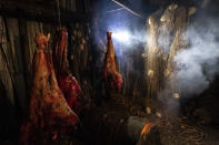 Unused salmon nets hang next to moose meat in the Stevens' smokehouse, which would normally be filled with salmon this time of year, on Wednesday, Sept. 15, 2021, in Stevens Village, Alaska. For the first time in memory, both king and chum salmon have dwindled to almost nothing and the state has banned salmon fishing on the Yukon. The remote communities that dot the river and live off its bounty are desperate and doubling down on moose and caribou hunts in the waning days of fall.(AP Photo/Nathan Howard)