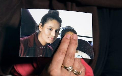 Renu, eldest sister of Shamima Begum, 15, holds her sister's photo  - Credit: PA