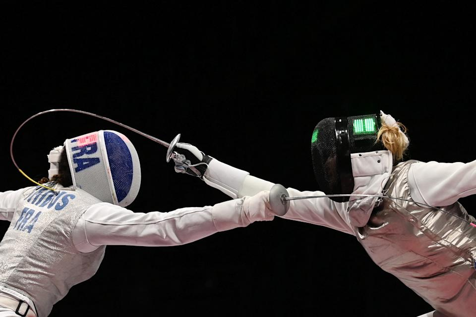 <p>France's Ysaora Thibus (L) compete against Hungary's Flora Pasztor in the women's foil individual qualifying bout during the Tokyo 2020 Olympic Games at the Makuhari Messe Hall in Chiba City, Chiba Prefecture, Japan, on July 25, 2021. (Photo by MOHD RASFAN / AFP) (Photo by MOHD RASFAN/AFP via Getty Images)</p>
