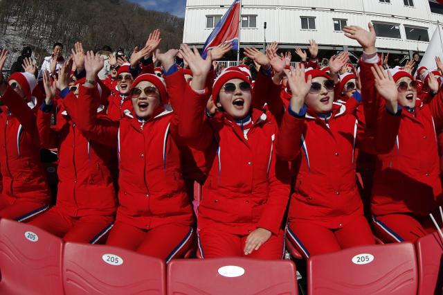 Alpine Skiing – Pyeongchang 2018 Winter Olympics – Women's Slalom – Yongpyong Alpine Centre - Pyeongchang, South Korea – February 16, 2018 - North Korean cheerleaders react. REUTERS/Jorge Silva
