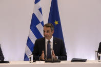 Greek Prime Minister Kyriakos Mitsotakis speaks during a meeting in Athens, on Wednesday, July 28, 2021. Greece is hosting a one-day trilateral meeting of the three leaders. (AP Photo/Yorgos Karahalis)