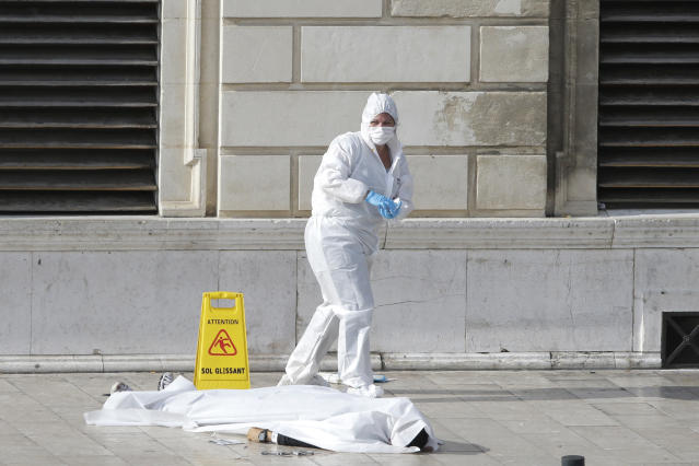 <p>Investigative police officers works by a body under a white sheet outside Marseille 's main train station, Oct. 1, 2017 in Marseille, southern France. A man with a knife attacked people at the main train station in the southeastern French city of Marseille on Sunday, killing two women before soldiers fatally shot the assailant, officials said. (AP Photo/Claude Paris) </p>