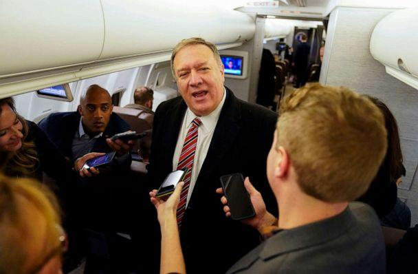 PHOTO: Secretary of State Mike Pompeo speaks to reporters aboard his plane en route to London, Jan. 29, 2020. (Kevin Lamarque/POOL/AFP via Getty Images)