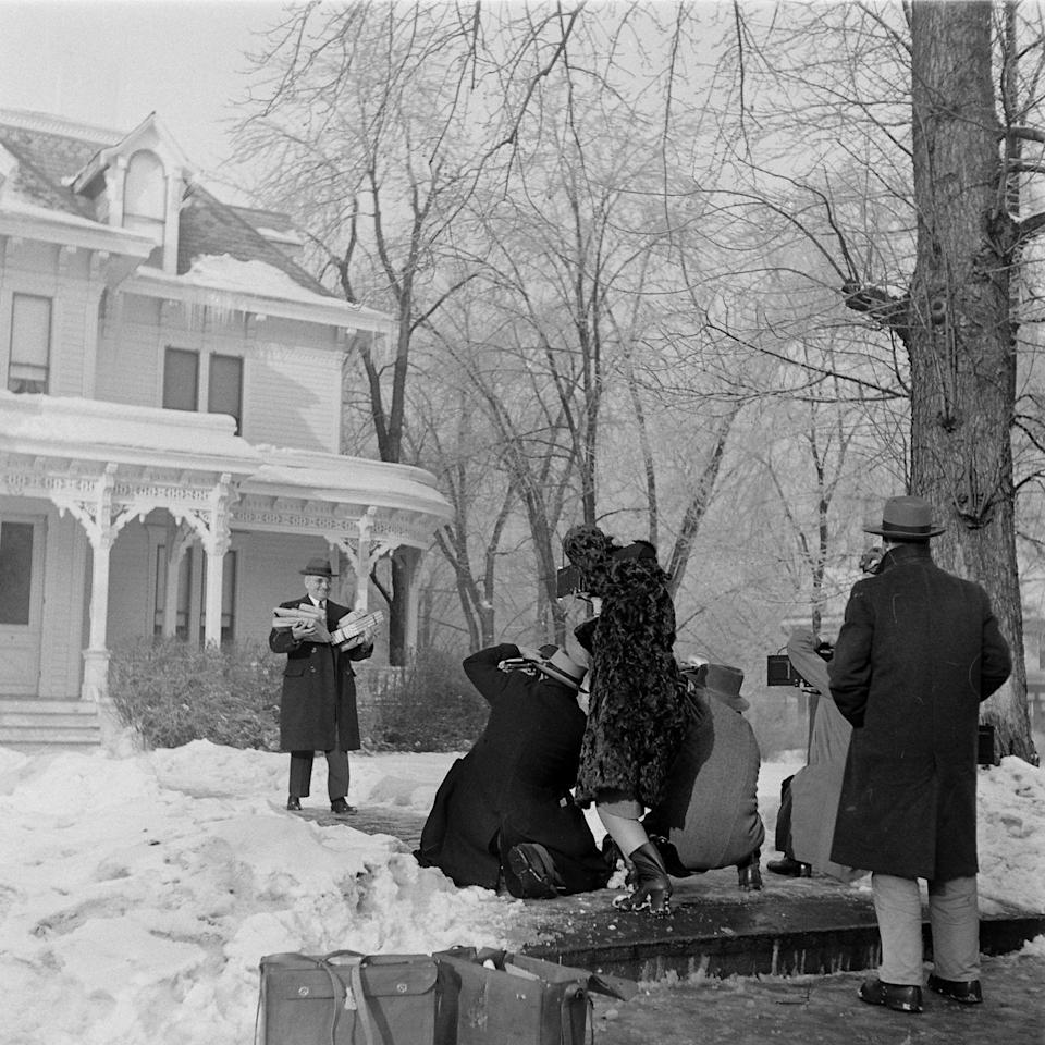 <p>President Truman poses for the press in front of his Kansas City, Missouri house, which he traveled to for Christmas with his family. </p>