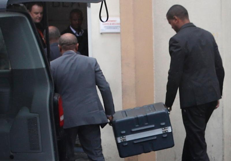 Two men carry suitcases containing the flight recorders from the Ethiopian jet, into the French air accident investigation authority, Thursday, March 14, 2019 in Le Bourget, north of Paris.