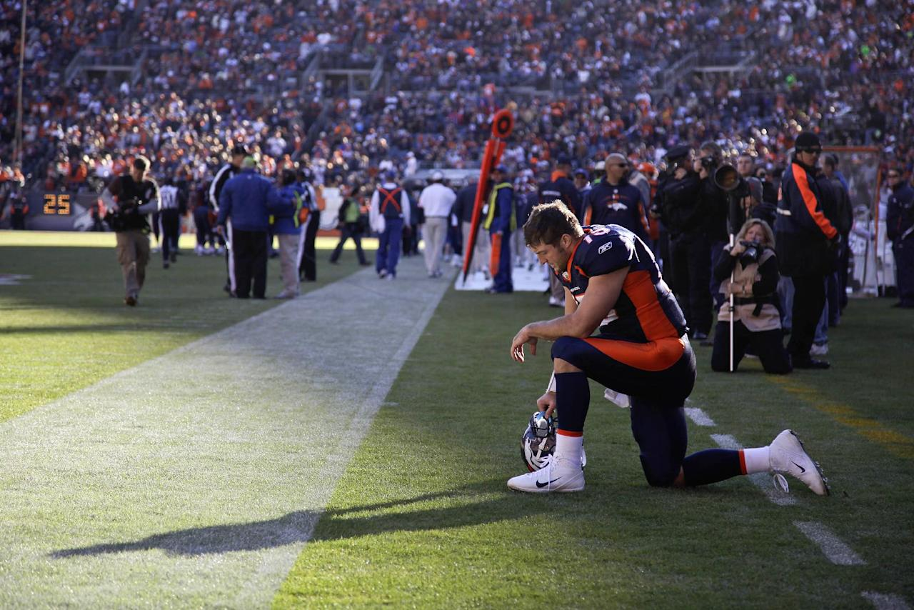 FILE - In this Dec. 11, 2011 file photo, Denver Broncos quarterback Tim Tebow prays in the end zone before the start of an NFL football game against the Chicago Bears, in Denver. Peyton Manning is negotiating to join the Broncos, ESPN reported Monday, March 19, 2012. Citing anonymous sources, ESPN said that the four-time MVP has instructed agent Tom Condon to negotiate the details of a deal with Denver. The addition of Manning could well lead to Denver trading Tebow, even though the popular QB energized the Broncos in leading them to the playoffs last season despite some uneven play. (AP Photo/Julie Jacobson, File)
