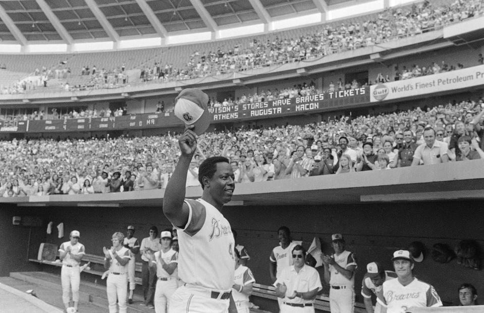 Hank Aaron of the Atlanta Braves reacts Saturday, July 21, 1973, in Atlanta after hitting 700th career home run against the Philadelphia Phillies. (AP Photo)