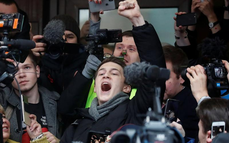 Russian protester Yegor Zhukov reacts after a court hearing in Moscow - REUTERS
