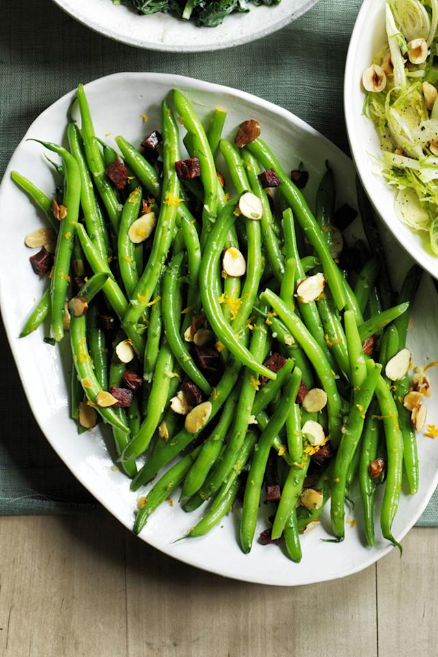 """<p>Chroizo, whether spicy or sweet, amps up this blanched green beans dish.</p><p><a rel=""""nofollow"""" href=""""http://www.womansday.com/food-recipes/food-drinks/recipes/a60489/green-beans-with-chorizo-and-almond-crumbs-recipe/""""></a><strong><a rel=""""nofollow"""" href=""""http://www.womansday.com/food-recipes/food-drinks/recipes/a60489/green-beans-with-chorizo-and-almond-crumbs-recipe/"""">Get the recipe.</a></strong></p><p><strong>Tools you'll need:</strong> <em>$32, Lodge Cast Iron Dutch Oven, <a rel=""""nofollow"""" href=""""https://www.amazon.com/gp/product/B00063RWYI/ref=s9_acsd_top_hd_bw_b1DOU_c_x_1_w?tag=syndication-20"""">amazon.com</a>.</em></p>"""