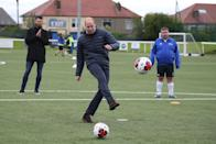 <p>Playing soccer during a visit to Spartans FC's Ainslie Park Stadium on May 21, 2021 in Edinburgh, Scotland.</p>