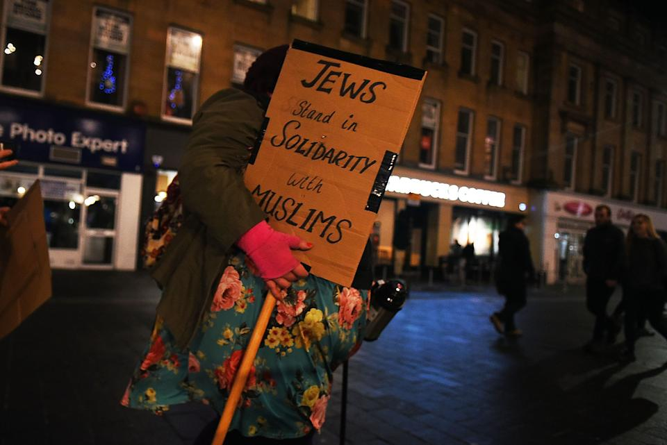 A young woman carries a sign of protest as she joins hundreds of people gathering together around Grey's Monument to protest against President Donald Trump and his policies, on January 30, 2017 in Newcastle, England. President Trump signed an executive order on Friday banning immigration to the USA from seven Muslim countries. This led to protests across America and the UK.