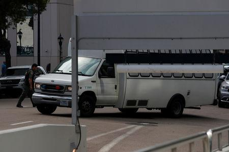 A vehicle, carrying asylum seekers brought from Tijuana, Mexico to the United States for their immigration hearing, arrives at a court in San Diego, California, U.S., March 19, 2019. REUTERS/ Mike Blake
