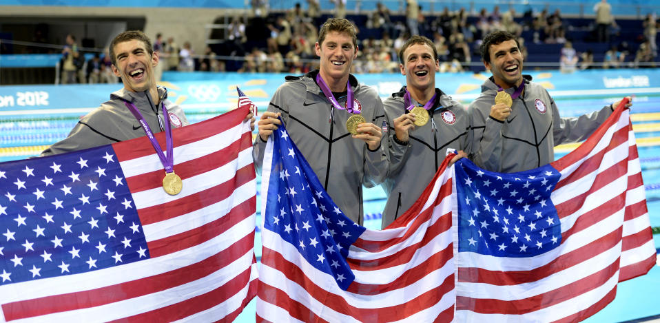 """From left, United States' <a href=""""http://sports.yahoo.com/olympics/swimming/michael-phelps-1131796/"""" data-ylk=""""slk:Michael Phelps"""" class=""""link rapid-noclick-resp"""">Michael Phelps</a>, <a href=""""http://sports.yahoo.com/olympics/swimming/conor-dwyer-1132798/"""" data-ylk=""""slk:Conor Dwyer"""" class=""""link rapid-noclick-resp"""">Conor Dwyer</a>, <a href=""""http://sports.yahoo.com/olympics/swimming/ricky-berens-1133268/"""" data-ylk=""""slk:Ricky Berens"""" class=""""link rapid-noclick-resp"""">Ricky Berens</a> and <a href=""""http://sports.yahoo.com/olympics/swimming/ryan-lochte-1132448/"""" data-ylk=""""slk:Ryan Lochte"""" class=""""link rapid-noclick-resp"""">Ryan Lochte</a> pose with their gold medals for the men's 4x200-meter freestyle relay swimming final at the Aquatics Centre in the Olympic Park during the 2012 Summer Olympics in London, Tuesday, July 31, 2012. (AP Photo/Mark J. Terrill)"""
