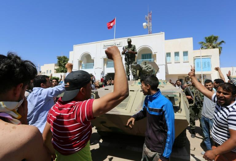 Tunisia forces clash with protesters, one killed, stations burned