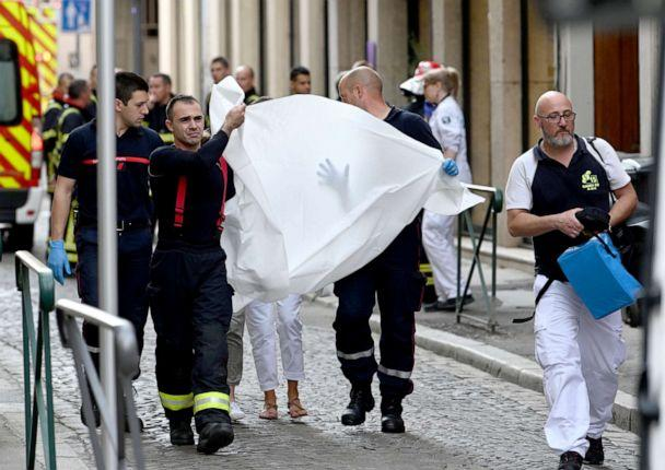 PHOTO: Emergency workers carry a person injured in suspected package bomb blast along a pedestrian street in the heart of Lyon, southeast France, the local prosecutors' office said, May 24, 2019. (Philippe Desmazes/AFP/Getty Images)