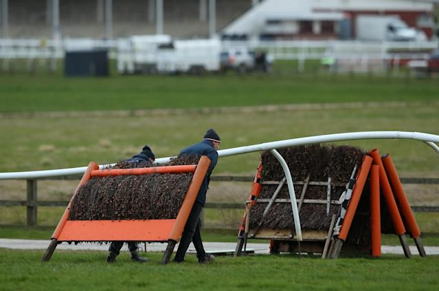 Ground staff pack away the hurdles at the end of the day after Wetherby Races is run behind closed doors due to Covid-19 at Wetherby Racecourse on March 17, 2020 in Wetherby, England. (Photo by Alex Livesey/Getty Images)