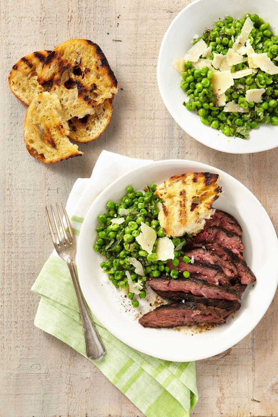 """<p>Put a fresh spin on the classic steak dinner. </p><p><strong><a href=""""https://www.countryliving.com/food-drinks/recipes/a37762/grilled-cumin-rubbed-hanger-steak-smashed-minty-peas-grilled-bread-recipe/"""" rel=""""nofollow noopener"""" target=""""_blank"""" data-ylk=""""slk:Get the recipe"""" class=""""link rapid-noclick-resp"""">Get the recipe</a>.</strong></p>"""