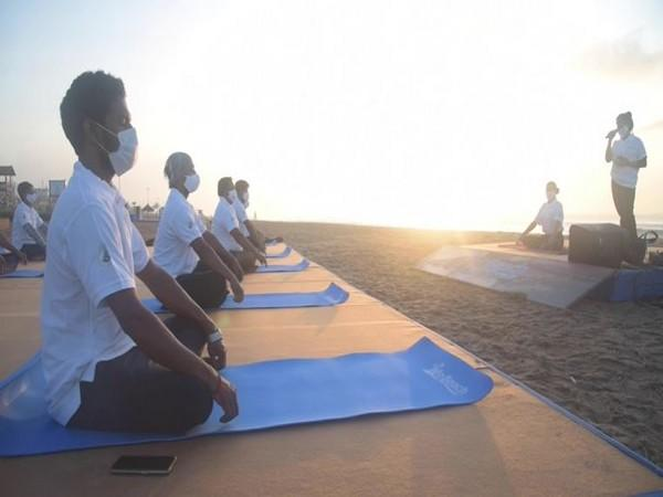 Recovered COVID-19 patients practicing Yoga at the Golden Beach. (Photo/ANI)