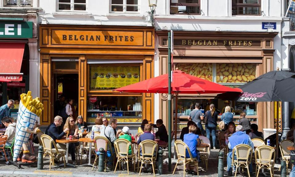 Frite shops in Brussels. In 2018, Belgium produced five million tonnes of processed potatoes, 16 times its domestic needs.