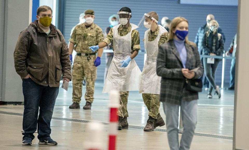 Soldiers direct people at The Exhibition Centre in Liverpool, which has been set up as a testing centre as part of the mass Covid-19 testing in Liverpool. (Photo by Peter Byrne/PA Images via Getty Images)