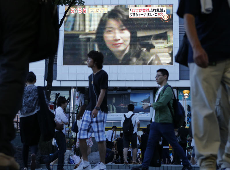 An image of Japanese journalist Mika Yamamoto is shown on a large monitor screen in Tokyo Tuesday, Aug. 21, 2012 during a TV news broadcast reporting her death in Syria. Yamamoto, a veteran war correspondent with The Japan Press, an independent TV news provider that specializes in conflict zone coverage, was killed Monday in the northwestern city of Aleppo, said Masaru Sato, a spokesman with the Foreign Ministry in Tokyo. (AP Photo/Itsuo Inouye)