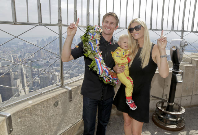 Indianapolis 500 winner Ryan Hunter-Reay poses for photos with his wife, Beccy Hunter-Reay, and son, Ryden, on top of the Empire State Building, Tuesday, May 27, 2014, in New York. Hunter-Reay defeated three-time Indy winner Helio Castroneves on Sunday and is the first American to win the race since 2006. (AP Photo/Julie Jacobson)