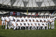 The New York Yankees pose for a team picture in London, Friday, June 28, 2019. Major League Baseball will make its European debut with the New York Yankees versus Boston Red Sox game at London Stadium this weekend. (AP Photo/Tim Ireland)
