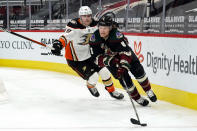 Arizona Coyotes defenseman Jakob Chychrun (6) shields the puck from Anaheim Ducks left wing, Max Jones, in the first period during an NHL hockey game, Monday, Feb. 22, 2021, in Glendale, Ariz. (AP Photo/Rick Scuteri)